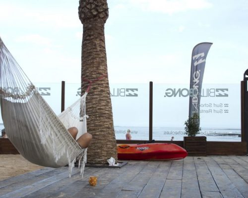 person relaxing in a hammock in the billabong surf camp in Corralejo
