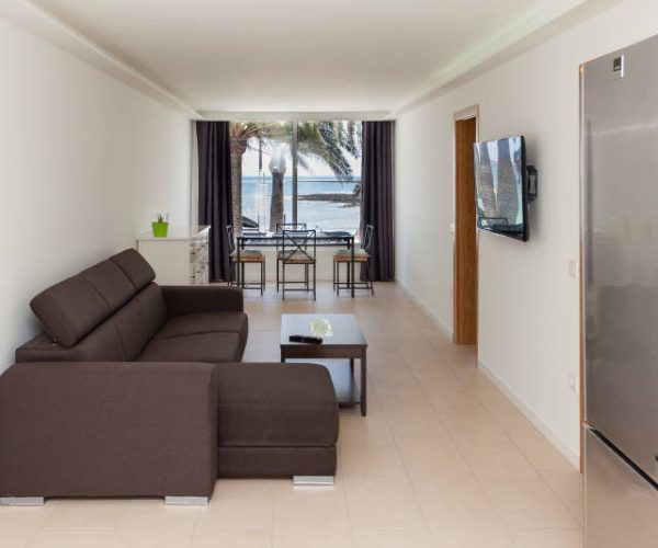 living room with seaview in surf camp accommodation in Corralejo