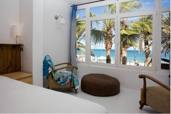 studio accommodation with kitchen and two double beds in a surf camp in Fuerteventura