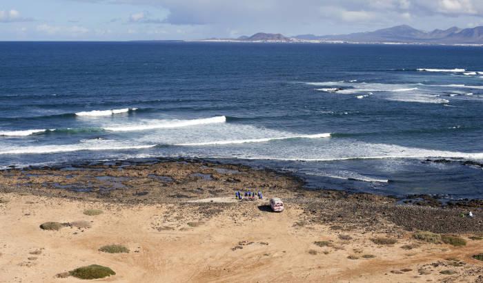 surf school Van parked in front of a reef break in fuerteventura