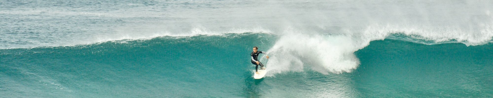 man surfing a right-hander wave