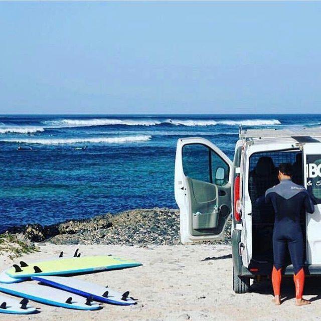 surfer in front of surf spot in fuerteventura